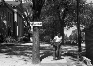"An African-American youth at a ""colored"" drinking fountain on a courthouse lawn in Halifax, North Carolina, 1938"