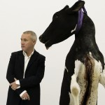British artist Damien Hirst poses beside one of his works - cow, in Kiev