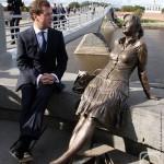 'Novgorodochka'. Sitting nearby - Russian Prime Minister Dmitry Medvedev
