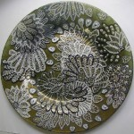 Created in Point-to-point technique decorative plate. Work by Russian artist of applied art Natalia Vorobyova