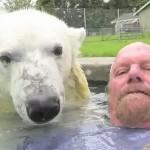 Posing on camera, Polar bear Agee and Mark Abbot Dumas