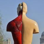 Sculpture Hymn by British artist Damien Hirst near the gallery, Tate Modern in London