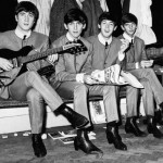 1963. The Beatles in matching outfits sitting on a bench. From left to right – John Lennon, 23, George Harrison, 20, Paul McCartney, 21, and Ringo Starr, 23