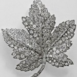 The Queen lent her Maple Leaf Brooch to the Canada-bound Duchess of Cambridge on her first royal tour last summer