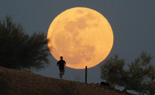 A man makes a run during Supermoon in Papago Park in Phoenix, Arizona