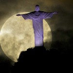 Moon in the sky behind the statue of Christ the Redeemer in Rio de Janeiro