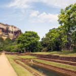 Sigiriya, framed by symmetrical water gardens which extend to the foot of the rock. It is one of the eight World Heritage Sites of Sri Lanka