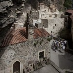 Prayers at 3,900ft: Visitors survey the incredible buildings of the Sumela monastery which was built, on southern shore of the Black Sea, during the reign of Emporer Theodosius I