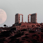 Supermoon of the temple of Poseidon at Cape Sounion, south-east of Athens, Greece.