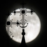 The top of the Orthodox church on the background of the full moon in Nowogrodek, 150 km west of Minsk, Belarus.