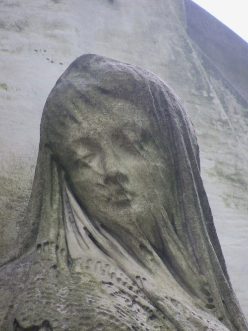 Warsaw. Powązki. Tomb sculpture - woman with a veiled face.