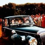 Riding a car with her son Charles, Elizabeth II