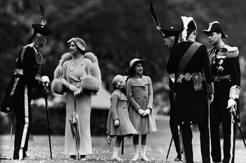 July 5, 1937, Elizabeth, a young princess, chats to Lord Elphinstone during a royal inspection of the Royal Company of Archers at Holyrood Palace in Edinburgh