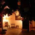 Madame Claude's in Berlin, decorated with chairs, furniture and lighting hanging upside down from the ceiling and walls