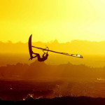 Windsurfer at sunset on the beach in Cape Town Blaauberg