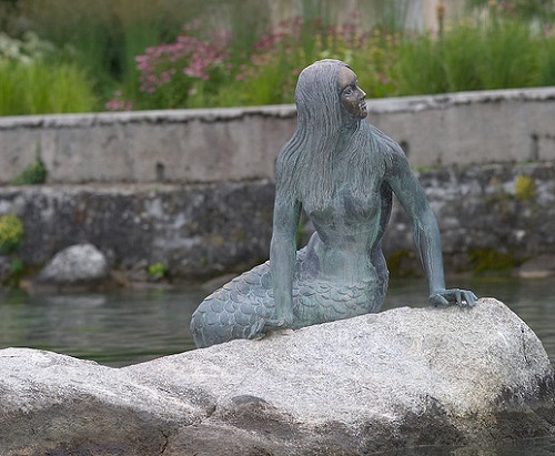 mermaid statue sculpture. Lake in Geneva, Switzerland
