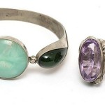Silver bracelet and two rings. Bracelet has an insertion of jadeite cut 'kabashon' shape 'circle' and 'pear'. Rings – with amethyst and onyx
