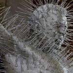 Golgotha, detail. Coat hangers and steel sculpture by David Mach