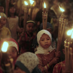 Muslim children lighted torches in a parade in honor of Eid al-Fitr holiday, which symbolizes the end of the fasting month of Ramadan in Jakarta, Indonesia