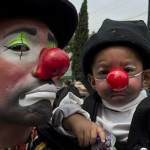 A clown and his son pose during a pilgrimage to the Virgin of Guadalupe's basilica, Mexico's patron saint, in Mexico City on July 18, 2012. Hundreds of clowns take part in the annual pilgrimage to the sanctuary of the Virgin.