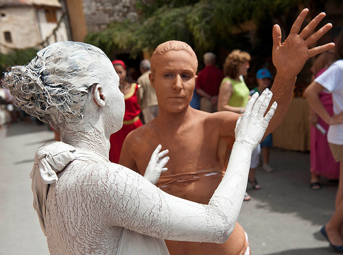 Cast in the form of clay sculpture at the parade in the village of Banos de Valdearadose, Spain