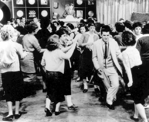 American Bandstand first aired as a local show in Philadelphia, gained popularity with host Dick Clark after he joined the program in 1956, and then went national in 1957