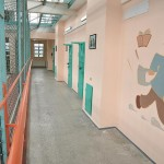 "The corridor sections for ""youngsters"", walls painted with cheerful pictures. To date, there are 16 young people here"