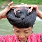 Carefully combed long hair in a hairdo. A woman of Huangluo Yao, the Chinese village