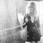 Blonde girl in the rain