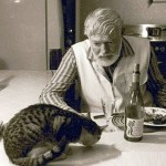 Dinner with a cat. Ernest Hemingway and his cats