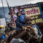 Young Hindu pilgrims wait on horses during a traffic jam on a path as they are guided by Kahsmiri men