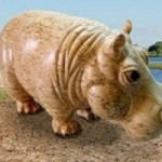 Beautiful miniature figure of the hippo, wood carving. Work by Russian sculptor wood carver Andrew Skorobogatyi