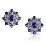 Dentelle de Perles Ear Studs. A mosaic of diamonds, recalling soft white embroidered summer dresses, set with 16 blue cabochon sapphires, totalling 16.9 carats. This piece is set in 18 carat white gold and features 91 diamonds, cabonchon sapphires and ruby totalling 16.9 carats.