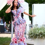 Gorgeous brunette in Flower outfit. fashion show in Moscow