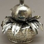 Pomegranate in a basket. Timeless jewelry art by Gianmaria Buccellati