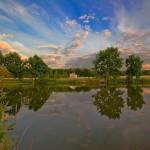 Low sky over the lake. Photo by Aleksandr Danilin