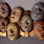 Depicting the sins masks. Their mouths are open, so that notes can be dropped through the mouths into the sections of the box behind them, informing on sinners in different categories