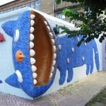 Impressive blue cats decorate the walls. Landscape alley urban project by sculptor Konstantin Skretutsky