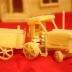 Tractor with a cart. Macaroni sculpture by Russian creative designer Sergei Pakhomov