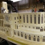 A small copy of Notre Dame Cathedral. Matchstick architecture by American artist Patrick Acton