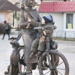 Postman Pechkin with a cat and a dog, sculptural composition based on popular cartoon. Ramenskoye