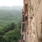 The stairs were originally made of wood, but now they are metal. Tourist attraction – The Maijishan Grottoes. Gansu Province, China