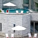 The balcony has sun loungers, you can sunbathe. Tschuggen Grand hotel in Arosa, Switzerland