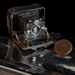Creative still life with a vintage camera. Work by Russian photographer Alexander Knyazev