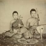 Musicians. Vintage photograph of Siamese men