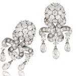 Anne Hathaway's 'Chandelier' earclips and rubellite and diamond 'Looped' ring to the 2009 Tony Awards