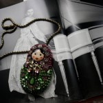 "A Russian Matryoshka doll necklace, accessories by ""Hanna Bernhard"" French jewelry designers"