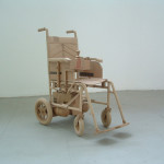 A wheel chair. Cardboard sculpture by British artist Chris Gilmour