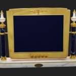 Light, elegant and whimsical, the computer flat screen has been handmade in brass, engraved bronze and alabaster, malachite or lapis lazuli, while all the metals parts are in gold