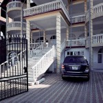 Stairs, balconies, and cars - pride of residents of Buzesku, Romania